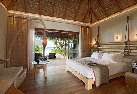 456b_constance-moofushi-resort_beach-villa-bedroom.jpg
