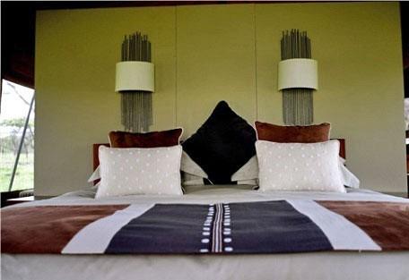 Naboisho-Camp-bed.jpg
