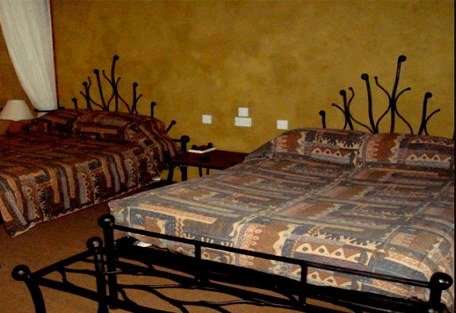 456b_serengeti-sopa-lodge-bedroom.jpg